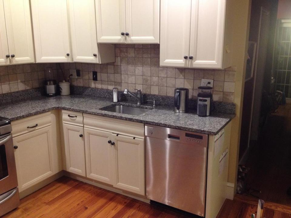 AFTER: The kitchen with new cabinets, floors, backsplash, and counters. The entire family helped install the updates.